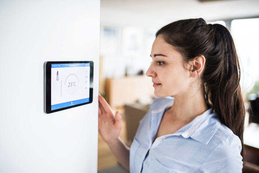 Woman Configuring Wireless Security System