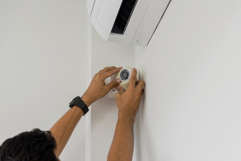 Technicians are installing a cctv camera